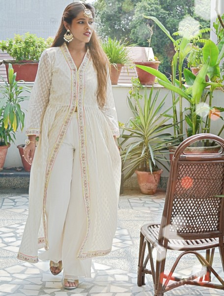 white ethnic suit